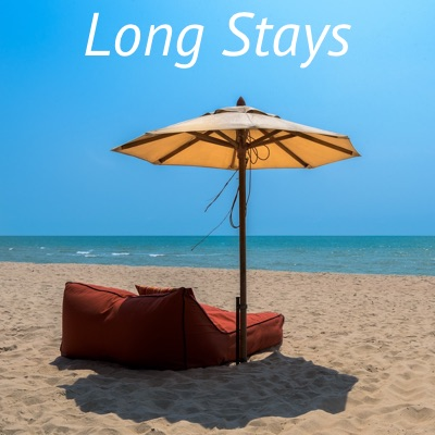 Lounging Sofa with Umbrella on Sandy Sun-drenched Beach